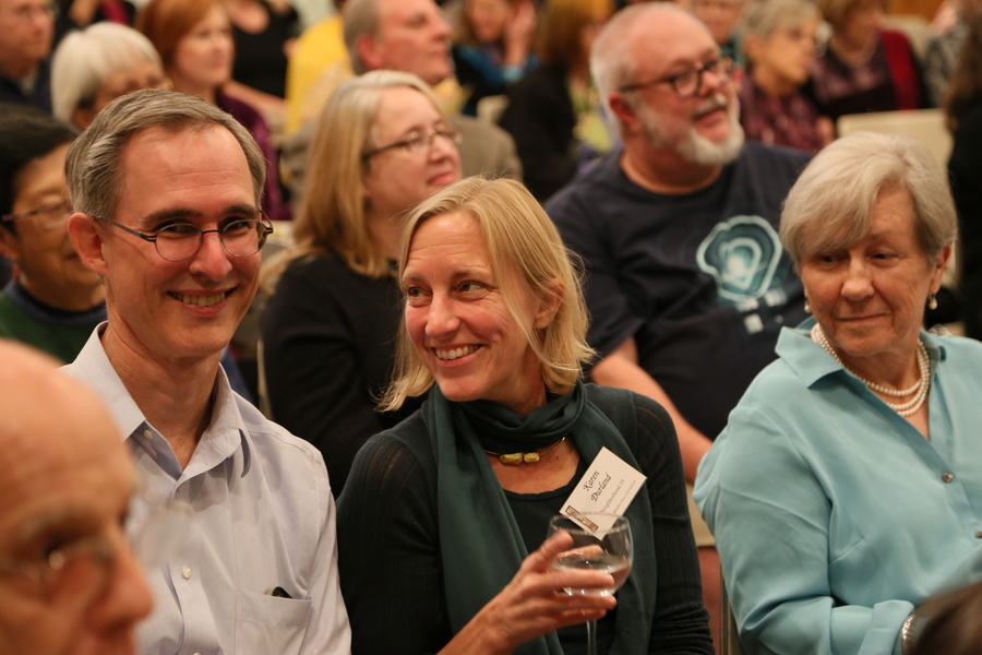 Picture of woman smiling at man next to her at annual church auction