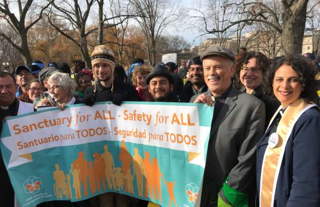 photo of Cedar Laner minister Rev. Katie Romano Griffin at a rally to support DACA and TPS, standing by others from DC who are part of the Sanctuary movement to support immigrants