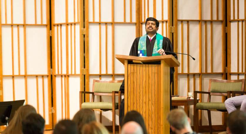Rev. Abhi Janamanchi i leading worship from the front of the Cedar Lane Sanctuary space