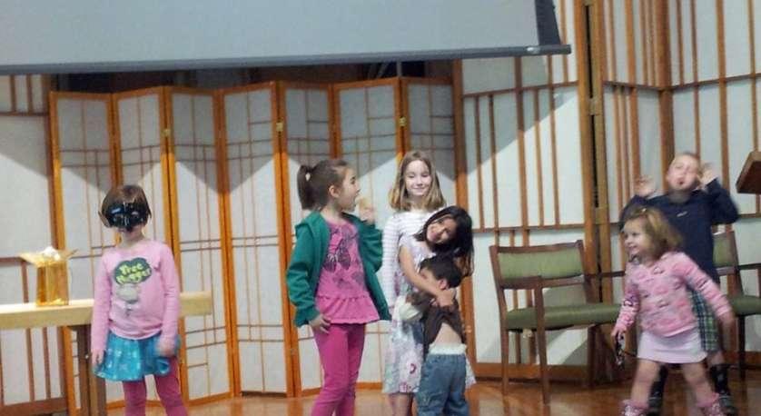 kids dancing around on the Cedar Lane sanctuary stage