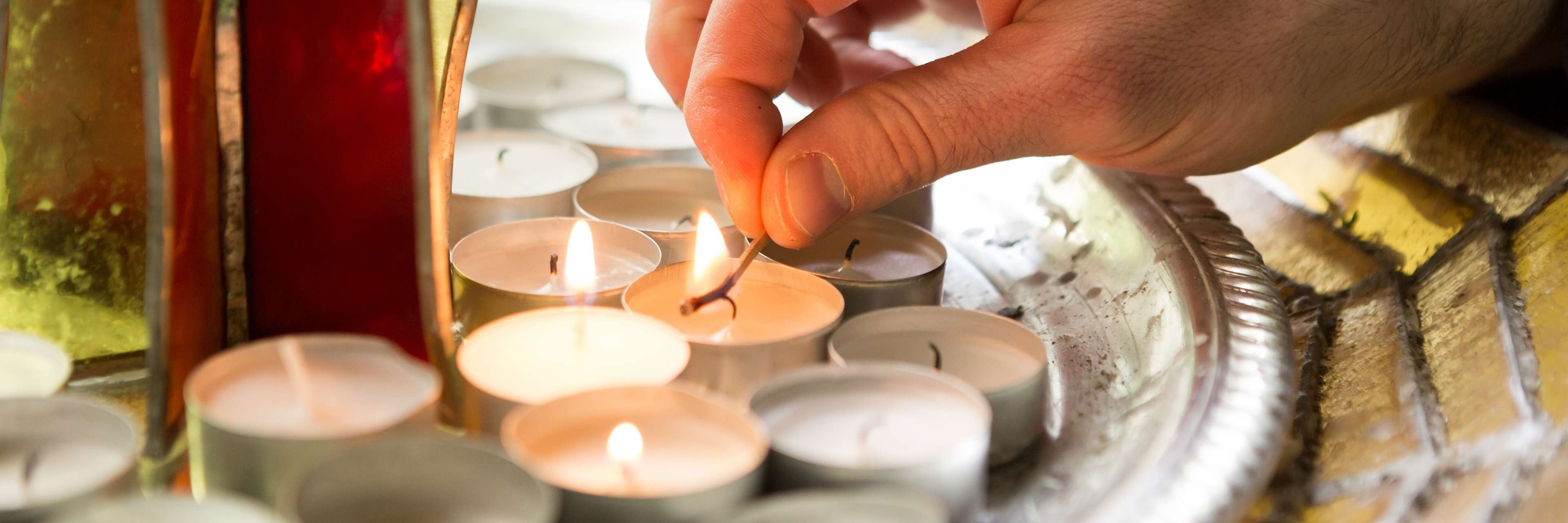 Hand writing a candle