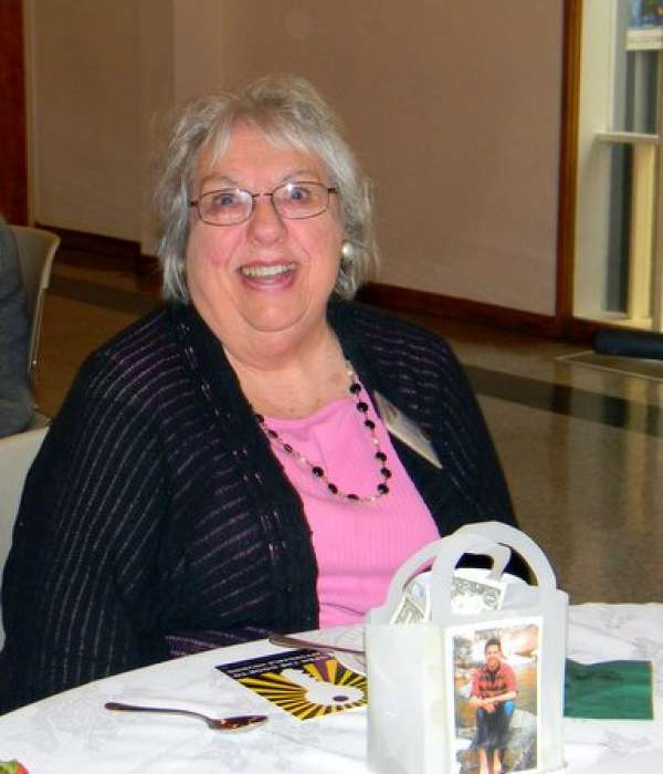 picture of Alliance member sitting at a table at the monthly luncheon