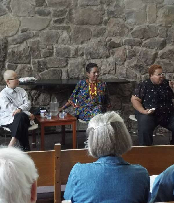 Yuri Yamamoto, Archene Turner, and Takiyah Amin speaking in the Cedar Lane Chapel after leading worship in 2017