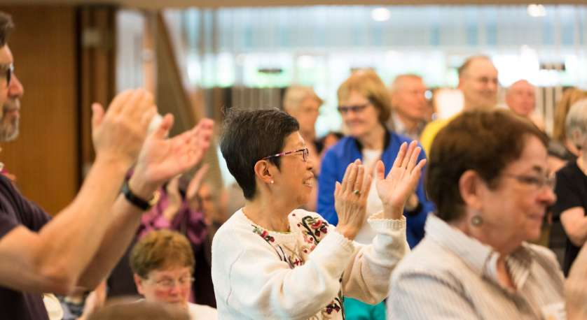 photo of Cedar Lane members clapping during a Sunday Worship Service