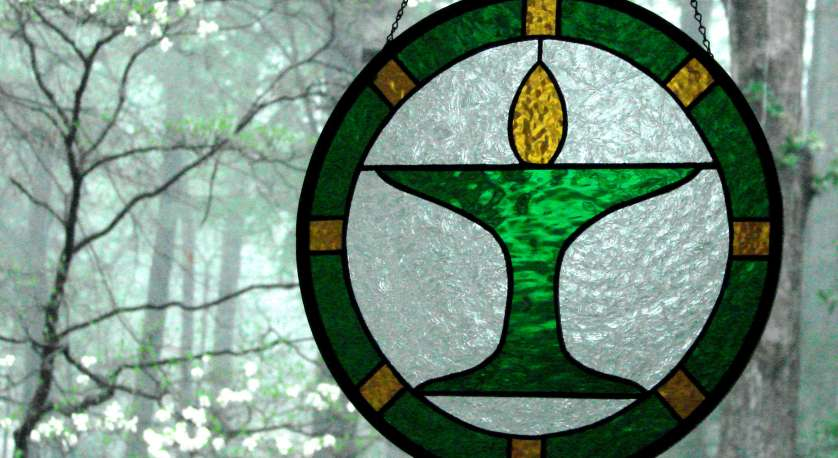 stained glass chalice art hanging in the Library window at Cedar Lane
