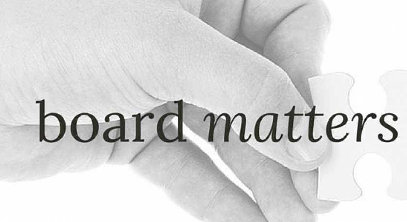 graphic for Board Matters news column with two hands reaching to each other holding puzzle pieces