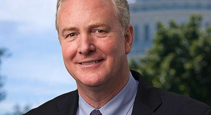 headshot for Maryland Senator Chris Van Hollen in suit and tie with Capitol in backdrop