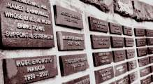Cedar Lane's memory wall at the Chalice House with nameplates of those Cedar Lane members who have died