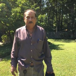 headshot of Pedro Diaz, Cedar Lane's custodian, in the courtyard