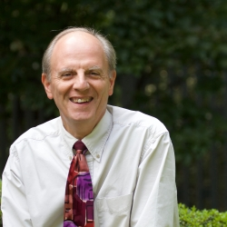 headshot of Henry Sgrecci, Music Director of Cedar Lane, in courtyard of Cedar Lane